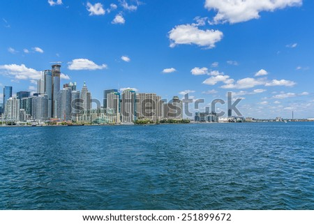 TORONTO, CANADA - JULY 23, 2014: The beautiful Toronto's skyline over Lake Ontario. Urban architecture.