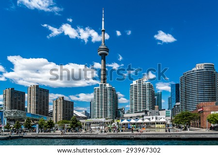TORONTO, CANADA - JULY 23, 2014: The beautiful Toronto's skyline over Lake Ontario. Urban architecture.  - stock photo