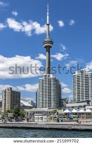 TORONTO, CANADA - JULY 23, 2014: The beautiful Toronto's skyline with CN Tower over lake. Urban architecture. Ontario. - stock photo