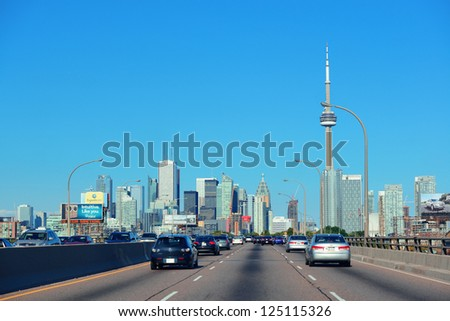 TORONTO, CANADA - JULY 3: Toronto highway with cityscape on July 3, 2012 in Toronto, Canada. Toronto with the population of 6M is the provincial capital of Ontario and the largest city in Canada. - stock photo
