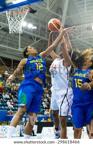 TORONTO,CANADA-JULY 16, 2015: Toronto 2015 Pan Am or Pan American Games, women basketball: Brazil's Karina Jacob (12) and Kelly Santos (15) try to avoid Alaina Coates  (15) to score.CN 01953074