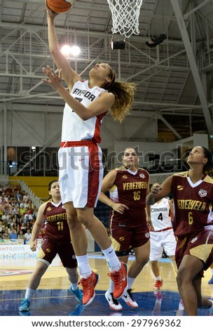 TORONTO,CANADA-JULY 16,2015: Toronto 2015 Pan Am or Pan American Games, women basketball: Nayo Raincock-Ekwune (7) from team Canada high jump and scores a two point shot.CN 01953074 - stock photo