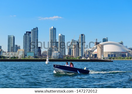 TORONTO, CANADA - JULY 3: Toronto skyline with boat on July 3, 2012 in Toronto, Canada. Toronto with the population of 6M is the provincial capital of Ontario and the largest city in Canada. - stock photo