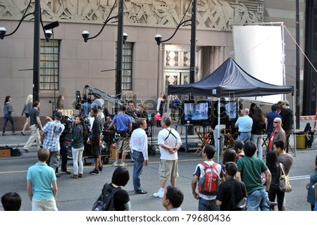 TORONTO, CANADA - JUN 17: Filming of the Duane Adler musical movie Cobu 3D, set in New York takes place in front of the Toronto Stock Exchange building on Bay St  June 17, 2011 in  Toronto, Ontario. - stock photo