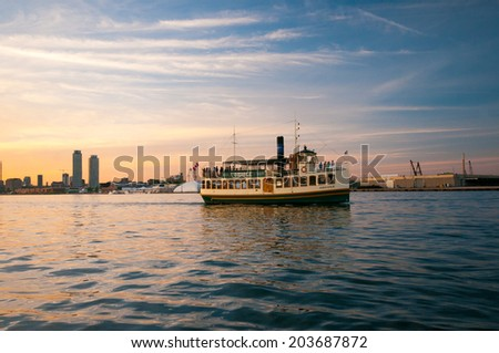 "TORONTO, CANADA - JUNE 7, 2014: A ferry named ""Oriole"" offering tours of Lake Ontario from the Toronto harbour."