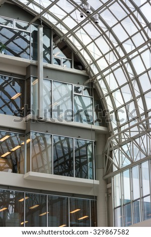 TORONTO,CANADA- JUNE 10,2015: Architectural detail: Close up view of a section of the glass roof at the Toronto Eaton Centre. The landmark is shopping centre and office complex in downtown