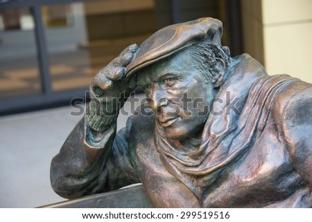 TORONTO,CANADA-JUNE 15,2015: Close-up of Life-sized bronze statue of Glenn Gould, sitting on a park bench outside the CBC Building in downtown Toronto. - stock photo