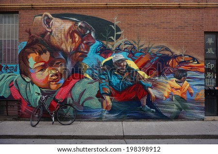 TORONTO, CANADA -- JUNE 11, 2014 -- Colorful murals line the walls in the Chinatown area of Toronto, the capital of Ontario, one of the largest Chinatowns in North America.