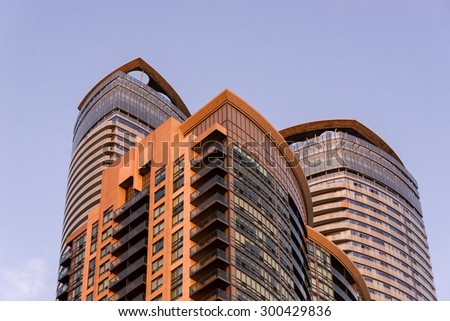 TORONTO,CANADA-JUNE 25,2015: Modern architecture detail of downtown Toronto.  Three buildings rise up into the sky at sunset. - stock photo