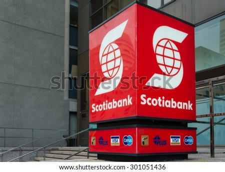 TORONTO,CANADA-JUNE 20,2015:Sign banner of the Scotiabank at the entrance to the building. Scotiabank is the third largest bank in Canada by deposits and market capitalization. - stock photo