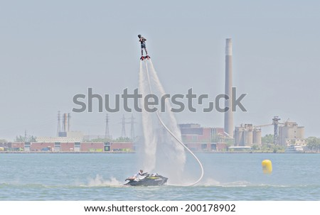 Toronto, Canada - June 22, 2014 : The world's newest extreme water sport call flyboarding at the 2014 Flyboard North American Championships happening at Harbour Square Park.