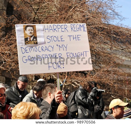 TORONTO, CANADA - MAR 31:  Protesters gathered to protest the alleged election fraud committed by the Conservatives in the last Canadian federal election Mar 31, 2012 in Toronto, Ontario. - stock photo