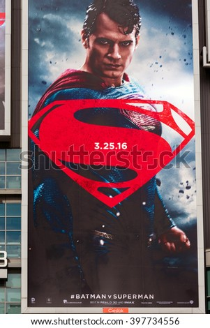 TORONTO,CANADA-MARCH 19,2016: Batman V Superman: Dawn of Justice advertisements in Dundas Square. The film is a 2016 American superhero film  distributed by Warner Bros. Pictures. - stock photo