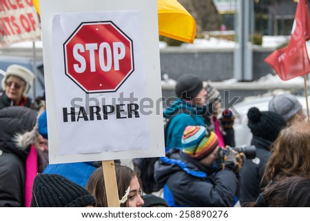 TORONTO,CANADA-MARCH 8,2015: Stop Harper sign.Thousands gathered in Toronto to mark International Women Day IWD with a protest march demanding improvements in many social issues. - stock photo