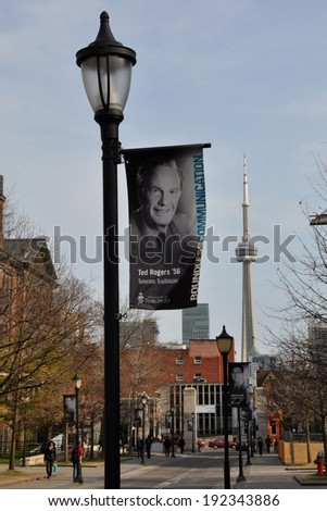 Toronto, Canada - May 9, 2014: A banner of Ted Rogers as one of the distinguished alumni of University of Toronto displayed along the university sidewalk.  - stock photo