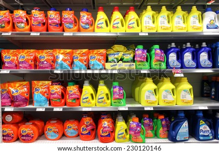 TORONTO, CANADA - MAY 06, 2014: Different types of detergents on shelves in a supermarket. Tide is a laundry detergent manufactured by Procter & Gamble and one of the top three brands of detergents.
