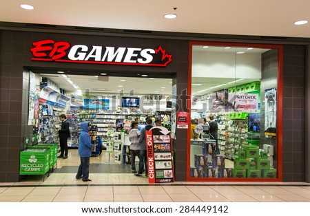 TORONTO,CANADA-MAY 17,2015: EB Games store in Eaton Centre. EB Games formerly known as Electronics Boutique and EB World is an American computer and video games retailer. - stock photo