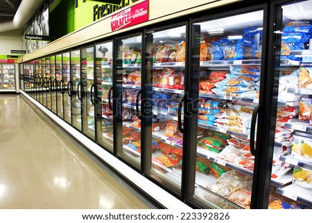 TORONTO, CANADA - MAY 06, 2014: Frozen foods aisle in a supermarket. In North America, consumption of frozen food has increased in recent years, mostly due to people's busy lifestyle. - stock photo
