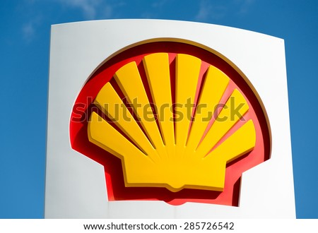 """TORONTO,CANADA-MAY 24,2015: Icon of company Shell over blue sky: Shell Oil Company is the United States-based subsidiary of Royal Dutch Shell, a multinational """"oil major"""" of Anglo-Dutch origins - stock photo"""