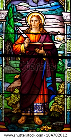TORONTO, CANADA - MAY 26: The stained glass window with religious motif at Corpus Christi church in Toronto on May 26, 2012 - stock photo