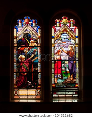 TORONTO, CANADA - MAY 26: The stained glass windows with religious motifs at Corpus Christi church in Toronto on May 26, 2012 - stock photo