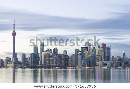 TORONTO, CANADA - NOVEMBER 02, 2015: Downtown Toronto skyline with the CN Tower  and the Financial District skyscrapers,  illuminated at sunset. - stock photo