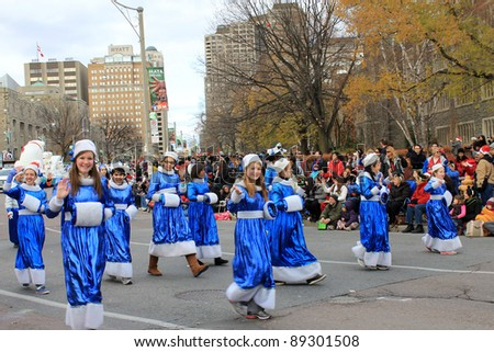 TORONTO, CANADA – NOVEMBER 20: Girls students  take part in Christmas Parade  November 20, 2011 in Toronto Downtown, Canada
