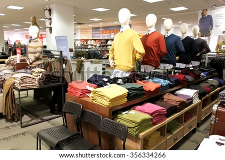 TORONTO, CANADA - OCTOBER 31, 2014: A view of men clothing department in a department retailer store on October 31, 2014. - stock photo