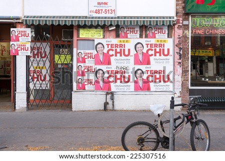 TORONTO,CANADA-OCTOBER 11, 2014: Terry Wu electoral signs in Chinatown is an ethnic enclave in Downtown with a high concentration of ethnic Chinese residents and businesses  - stock photo