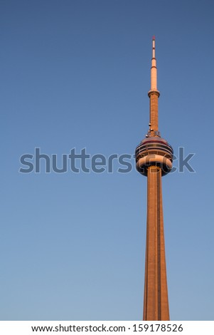 Toronto, Canada - October 8, 2013: The CN Tower at sunset in Toronto with a clear blue sky in the background on October 8 2013 - stock photo