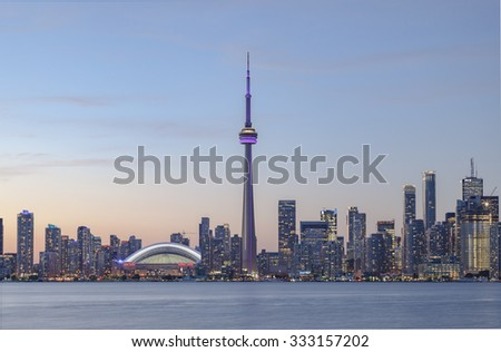 TORONTO, CANADA - SEPTEMBER 15, 2015: View of Downtown Toronto skyline with the CN Tower apex and financial  district at sunset. - stock photo