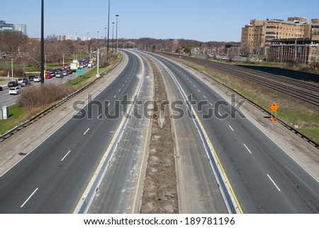 TORONTO, CANADA - 27TH APRIL 2014: The Gardiner Expressway during the day with no traffic due to consruction. On the left you can see diverted traffic on a different road. - stock photo