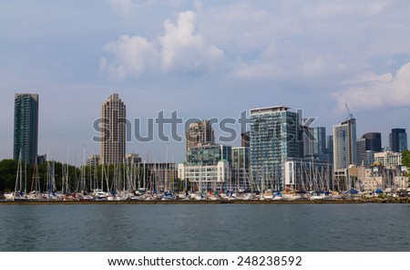 TORONTO, CANADA - 11TH AUGUST 2014: Part of a Harbor at the Toronto Waterfront with buildings in the background - stock photo