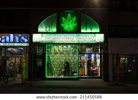 TORONTO, CANADA - 14TH AUGUST 2014: The outside of Toronto Hemp Company at night showing the exterior lit up