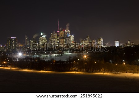 TORONTO, CANADA - 10TH FEBRUARY 2015: Downtown Toronto at Night in the Winter from Riverdale Park East - stock photo