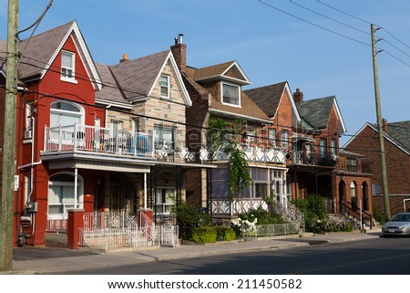 TORONTO, CANADA - 18TH JULY 2014: The outside of typical houses down a street in Toronto - stock photo