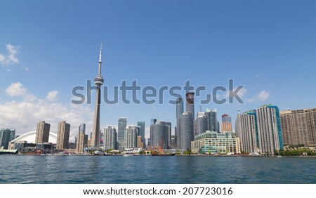 TORONTO, CANADA - 27TH JULY 2014: The Toronto Skyline from Lake Ontario during the day - stock photo