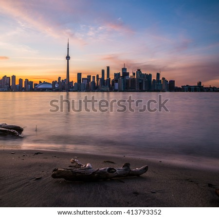 TORONTO, CANADA - 7TH JUNE 2015: Toronto Skyline during a colorful Sunset. Lots of buildings can be seen. - stock photo