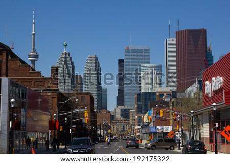 TORONTO, CANADA - 11TH MAY 2014: A view down Front Street towards Downtown Toronto during the day - stock photo