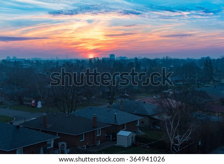 Toronto city beautiful Winter sunrise: 2015 cold season has been gentle looking more like Fall and featuring amazingly atypical sunrises. - stock photo