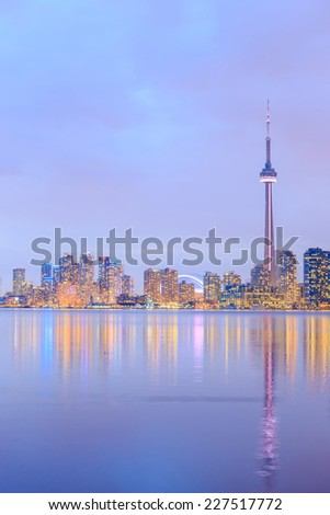 Toronto city dusk over lake with colorful light, canada. - stock photo
