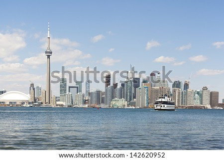 toronto city skyline with island ferry in harbour