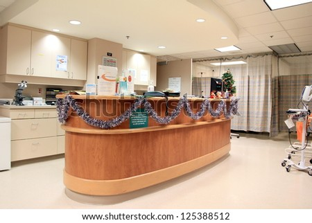 TORONTO - DECEMBER 20: A reception desk at the North York General Hospital on December 20, 2012 in Toronto. The hospital was opened in 1968 and currently has 434 beds. - stock photo