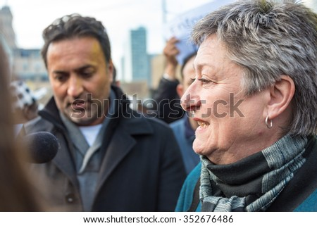 TORONTO,DECEMBER 9,2015: Councillor Janet Davis (lady) speaks to taxi drivers protesting the unfair operation of UberX outside City Hall. The city is working in regulating Uber so competion is fair. - stock photo