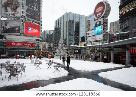 TORONTO - DECEMBER 29: Snow covers Yonge and Dundas Square. The snow storm hits Toronto, Canada on December 27, 2012 after knocking out power to thousands of homes in the U.S.. - stock photo