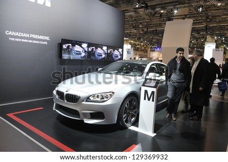 TORONTO-FEBRUARY 22: A BMW M6 gran coupe which was premiering in Canada on display  during the 40th International Auto Show on February 22, 2013 in Toronto, Canada. - stock photo