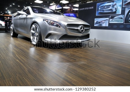 TORONTO-FEBRUARY 22: A 2014 Mercedes-Benz E-Class on display during the 40th International Auto Show on February 22, 2013 in Toronto, Canada. - stock photo