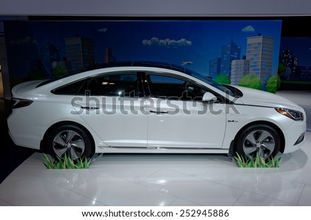 TORONTO-FEBRUARY 12: at the 2015 Canadian International Auto Show Sonata Hybrid has 2.4L DOHC Atkinson-cycle 4-cylinder engine and Lithium-ion Polymer Battery-powered electric motor - stock photo