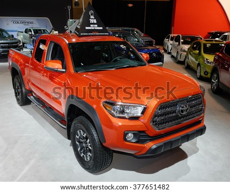TORONTO-FEBRUARY 12: at the 2016 Canadian International AutoShow. All new Toyota Tacoma TRD Off Road 4X4 comes with an amazing 29 different versions and engines from 159hp to 278hp 3.5 liter V-6 - stock photo