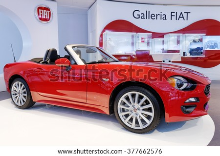 TORONTO-FEBRUARY 12: at the 2016 Canadian International AutoShow, the 2017 Fiat 124 Spider features distinctive Italian bodywork with the underpinnings from the Mazda MX-5 - stock photo